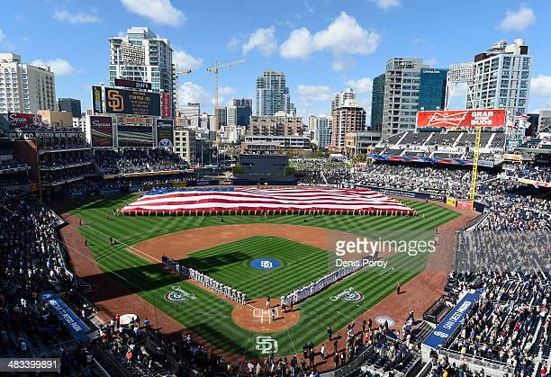 Players line up on the field during pregame festivities on Opening Day before a baseball game between the Los Angeles Dodgers and the San Diego...