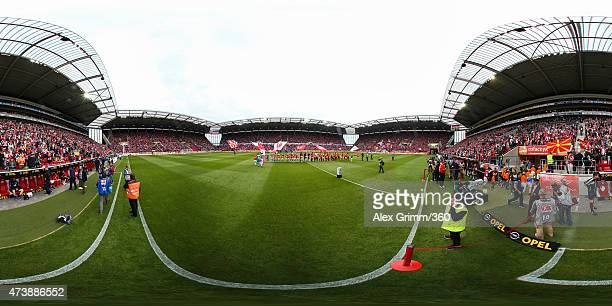 Players line up prior to the Bundesliga match between 1 FSV Mainz 05 and 1 FC Koeln at Coface Arena on May 16 2015 in Mainz Germany