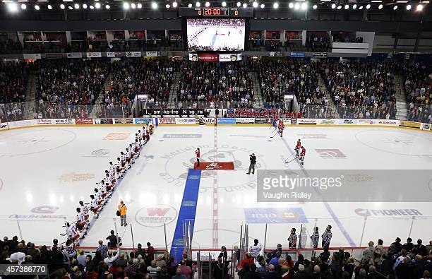 Players lineup for the the singing of the national anthem prior to the OHL game between the Belleville Bulls and the Niagara Ice Dogs at the Meridian...