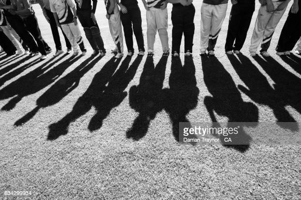 Players link arms before the National Indigenous Cricket Championships match between New South Wales and Victoria on February 9 2017 in Alice Springs...