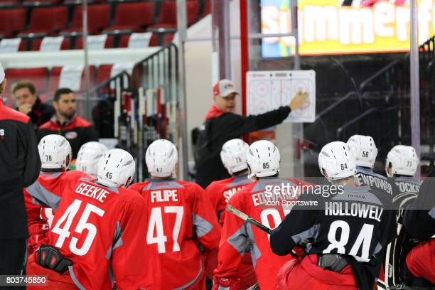 Players listen as Mike Vellucci the new head coach of the Charlotte Checkers instructs during the Carolina Hurricanes Development Camp on June 29...