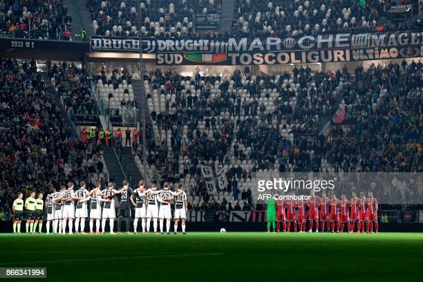 Players listen to a speaker reading a passage from the diary of holocaust victim Anne Frank before the Italian Serie A football match Juventus vs...