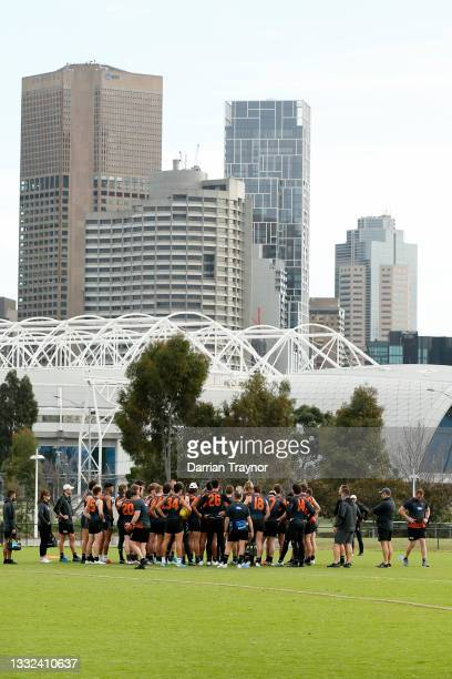 Players listen to instructions during a Greater Western Sydney Giants AFL training session at Holden Centre on August 05, 2021 in Melbourne,...