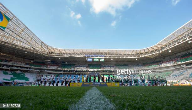 Players listen to the National Anthem before a match between Palmeiras and Corinthians in the final of Paulista Championship 2018 at Allianz Parque...