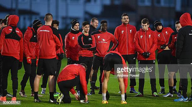 Players listen to their manager Jurgen Klopp during a training session at Melwood Training Ground on February 8 2016 in Liverpool England