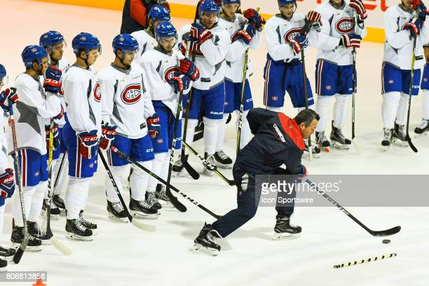 Players listening to coach showing an exercise during the Montreal Canadiens Development Camp on July 3 at Bell Sports Complex in Brossard QC
