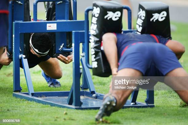 Players lock down in a scrum during a Melbourne Rebels Super Rugby training session at Gosch's Paddock on March 12 2018 in Melbourne Australia