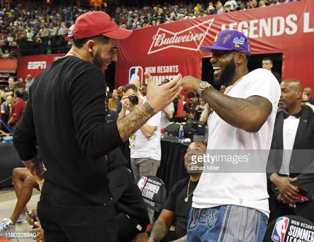 NBA players Lonzo Ball and LeBron James greet each other at the end of a game between the Chicago Bulls and the Los Angeles Lakers during the 2019...