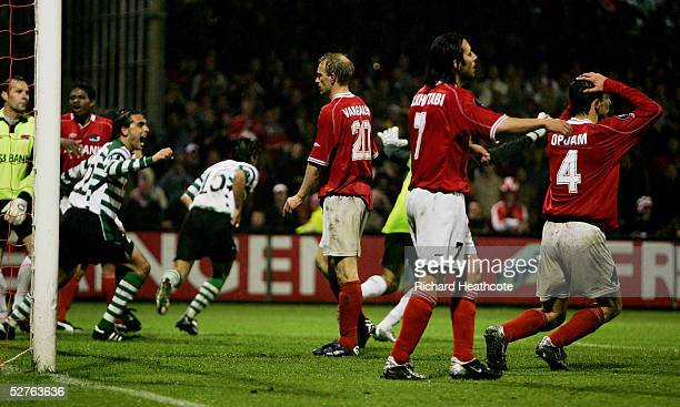 Players look dejected as Sporting celebrate scoring the winning goal in injury time of extra time during the UEFA Cup Semi Final 2nd Leg match...