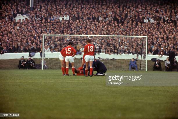 USSR players look on as a team mate is helped by the trainer No15 Khusainov No18 Banislevsky