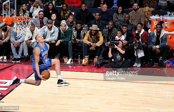 NBA players look on as Aaron Gordon of the Orlando Magic dunks in the Verizon Slam Dunk Contest during NBA AllStar Weekend 2016 at Air Canada Centre...