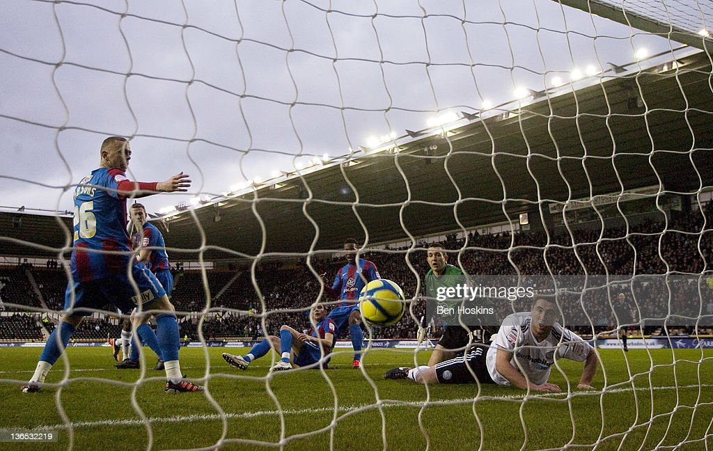 Players look on as the ball crosses the line from Theo Robinson's shot during the FA Cup sponsored by Budweiser Third Round match between Derby County FC and Crystal Palace FC at Pride Park on January 7, 2012 in Derby, England.