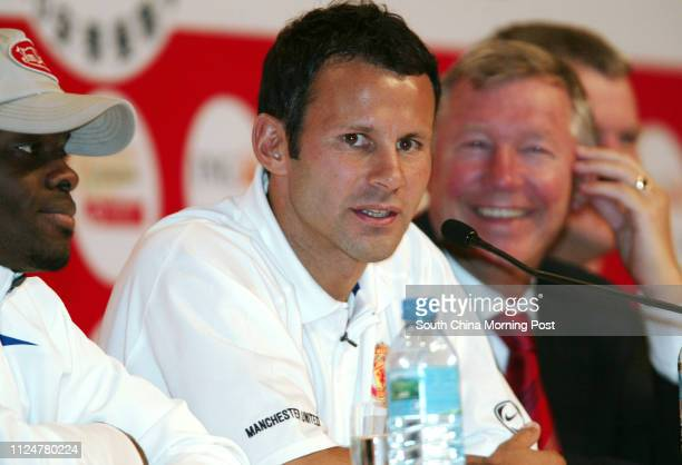 Players Louis Saha Ryan Giggs and manager Sir Alex Ferguson attend the Manchester United press conference at Grand Hyatt Hotel Hong Kong 22 July 2005