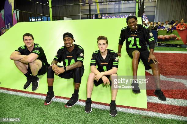 NFL players Luke Kuechly and Stefon Diggs actor Ricardo Hurtado and former NFL player Deion Sanders attend the Superstar Slime Showdown taping at...