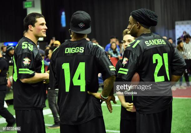 NFL players Luke Kuechly and Stefon Diggs actor Ricardo Hurtado and former NFL player Deion Sanders attend the Superstar Slime Showdown taping at at...