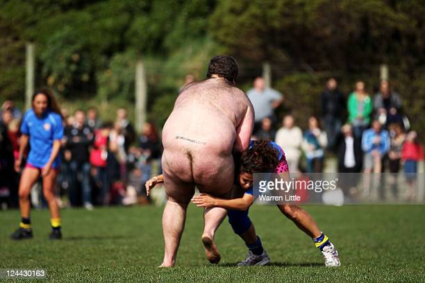 Players make a tackle during a nude rugby match between the Nude Blacks and Spanish Conquistadors at Dunedin Rugby Club Kettle Park on September 10...