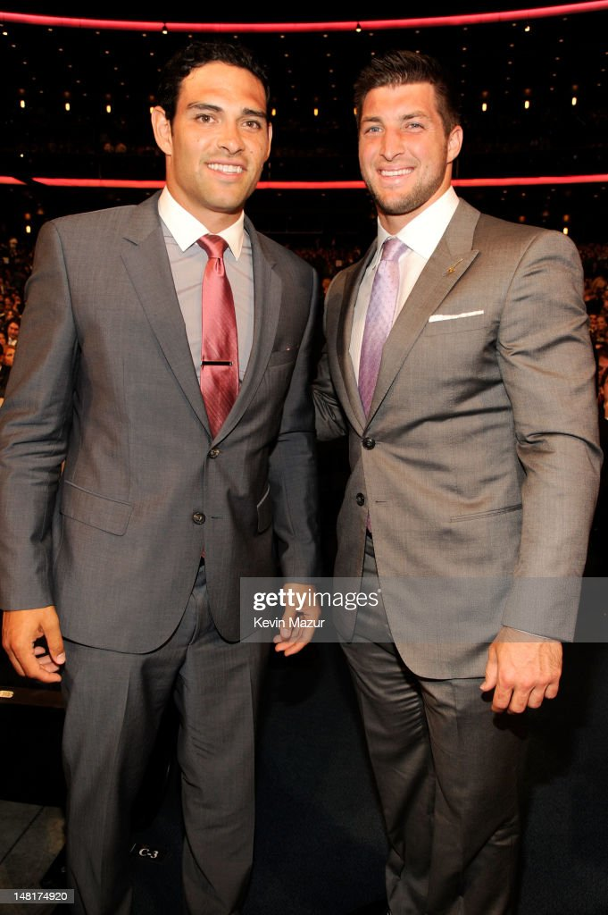 NFL players Mark Sanchez and Tim Tebow of the New York Jets attend the 2012 ESPY Awards at Nokia Theatre L.A. Live on July 11, 2012 in Los Angeles, California.