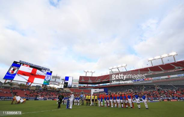 Players mascots and officials line up prior to the 2019 SheBelieves Cup match between England and Japan at Raymond James Stadium on March 05 2019 in...