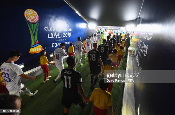 Players, mascots and officials walk out of the tunnel prior to the FIFA Club World Cup first round play-off match between Al Ain FC and Team...