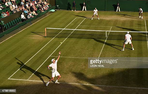 US players Mike Bryan and Bob Bryan play against India's Rohan Bopanna and Romania's Florin Mergea during their men's quarterfinals match on day...
