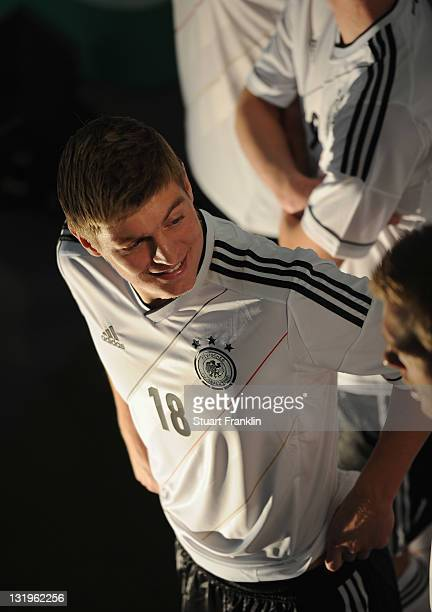 Players model shirts during the German national team Euro 2012 jersey launch at the Mercedes Benz center on November 9 2011 in Hamburg Germany
