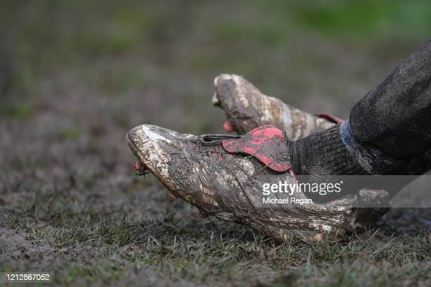 Players muddy boots during Sunday league football between Syston Brookside FC and Shepshed Oaks FC on March 15, 2020 in Leicester, England.