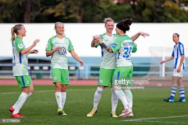 Players Noelle Maritz Pemille Harder Alexandra Popp Masar of VfL Wolfsburg celebrate a goal for Wolfsburg during the friendly match between VfL...