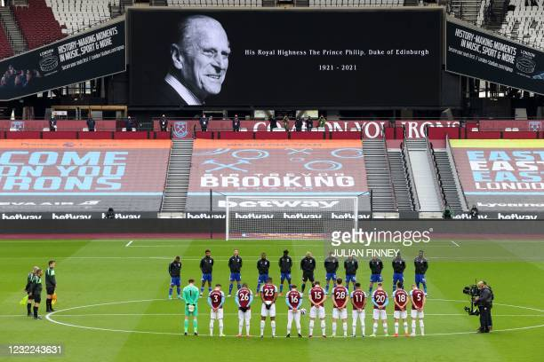 Players observe a 2-minute silence to mark the passing of Britain's Prince Philip, Duke of Edinburgh, ahead of the English Premier League football...