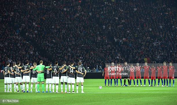 Players observe a minute of silence for the victims of Brussels terror attacks prior to the International Friendly match between Germany and England...