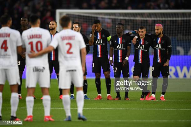 Players observe a minute of silence in honor of NBA legend Kobe Bryant, who was killed in a helicopter accident, prior to the French L1 football...