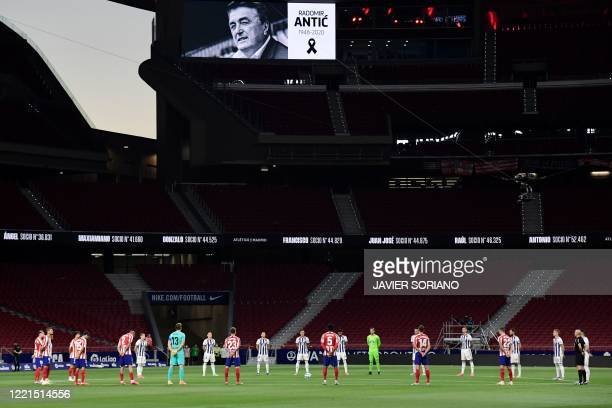 Players observe a minute of silence in memory of former Serbian player ans coach Radomir Antic before the Spanish League football match between...
