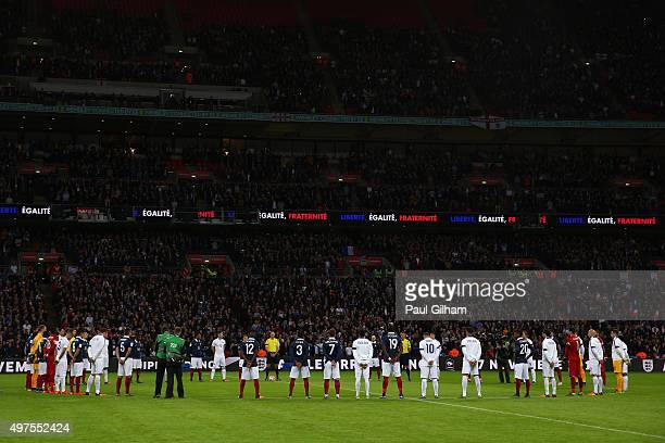 Players observe a minute of silence prior to the International Friendly match between England and France at Wembley Stadium on November 17 2015 in...