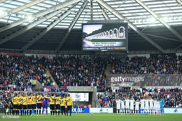Players observe a minute of silence to commemorate the Aberfan disaster victims prior to the Premier League match between Swansea City and Watford at...