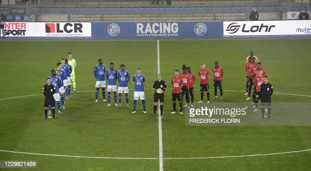 Players observe a minute of silence to pay a tribute to late Argentinian football player Diego Maradona by forming the letter M ahead of the French...
