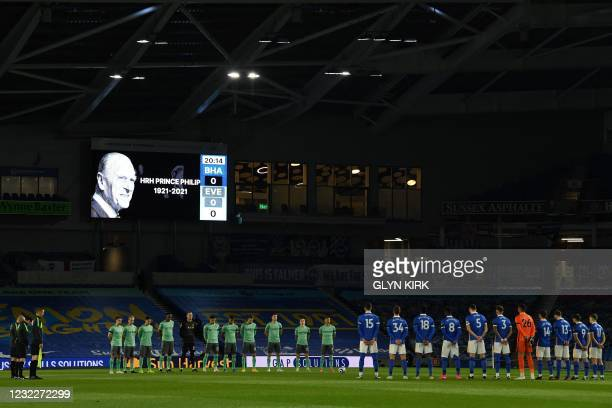Players observe a minute silence in honour of Britain's Prince Philip, Duke of Edinburgh, a few days after the duke died at the age of 99, prior to...
