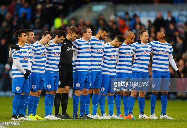 QPR players observe a minutes silence as they remember those who lost their lives in the Paris terrorist attacks during the Barclays Premier League...