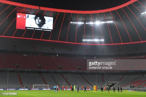 Players observe a minutes' silence for Argentine football legend Diego Maradona prior to the UEFA Champions League group A football match Bayern...