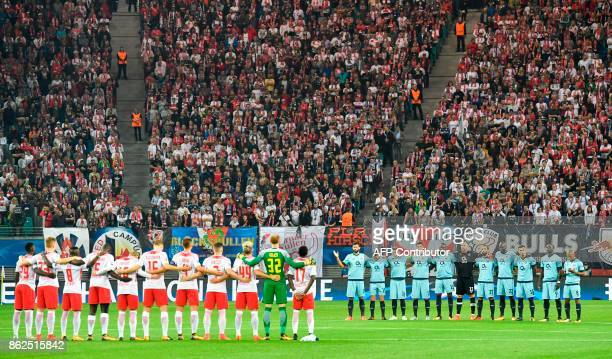 Players observe a minute's silence for the victims of the forest fires in Portugal prior to the UEFA Champions League group G football match RB...