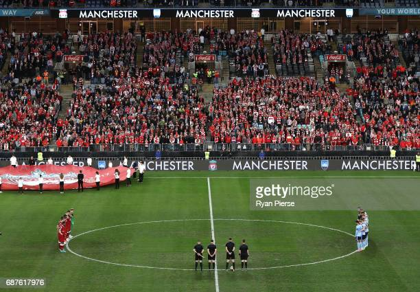 Players observe a minutes silence for the victims of the recent Manchester bombing during the International Friendly match between Sydney FC and...