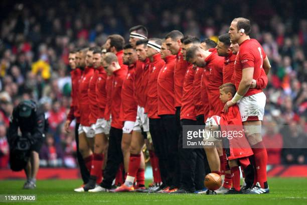 Players observe a minutes silence for victims of New Zealand shooting prior to the Guinness Six Nations match between Wales and Ireland at...