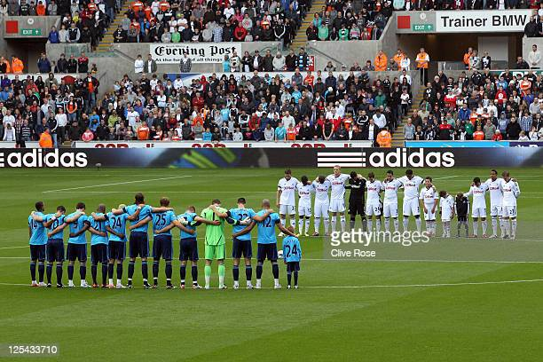 Players observe a minutes silence prior to the Barclays Premier League match between Swansea City and West Bromwich Albion at Liberty Stadium on...