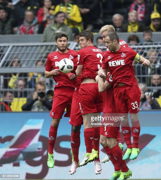 Players of 1 FC Cologne block a freekick during the Bundesliga soccer match between Borussia Dortmund and 1FC Cologne at the Signal Iduna Park in...