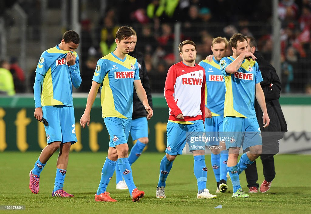 Players of 1. FC Koeln look dejected as they leave the pitch after the DFB Cup between SC Freiburg and 1. FC Koeln at Schwarzwald-Stadium on March 3, 2015 in Freiburg, Germany.