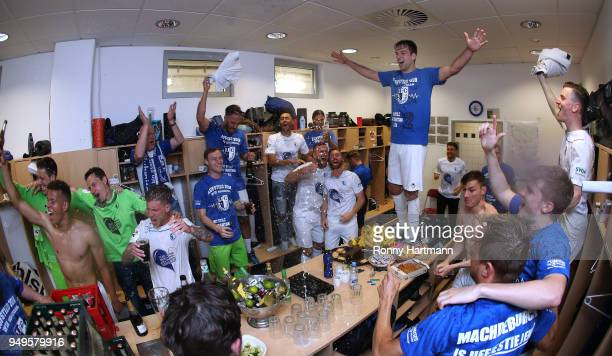 Players of 1 FC Magdeburg celebrate their promotion to Second Bundesliga after the 3 Liga match between 1 FC Magdeburg and SC Fortuna Koeln at...