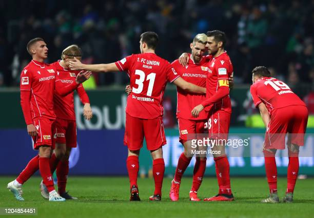 Players of 1 FC Union Berlin celebrate following the Bundesliga match between SV Werder Bremen and 1 FC Union Berlin at Wohninvest Weserstadion on...