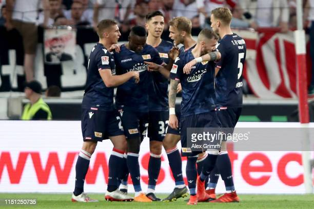 Players of 1 FC Union Berlin celebrate their team's first goal during the Bundesliga playoff first leg match between VfB Stuttgart and 1 FC Union...
