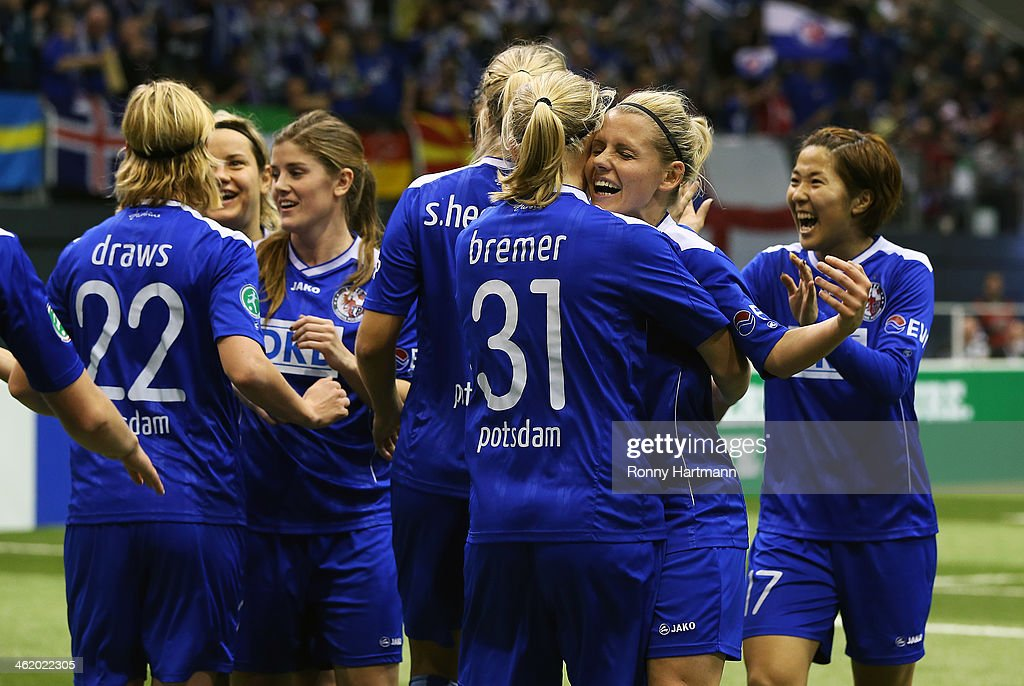 Players of 1. FFC Turbine Potsdam celebrate during the DFB Women's Indoor Cup 2013 at GETEC-Arena on January 12, 2014 in Magdeburg, Germany.