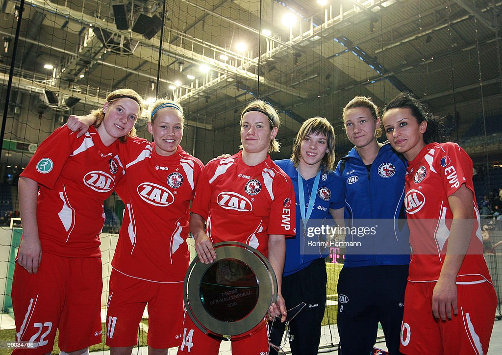 Players of 1. FFC Turbine Potsdam pose after winning the T-Home DFB Indoor Cup at the Boerdelandhalle on January 23, 2010 in Magdeburg, Germany.