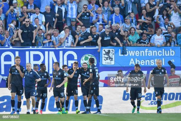 Players of 1860 Muenchen celebrate their first goal during the Second Bundesliga Playoff first leg match between Jahn Regensburg and TSV 1860...