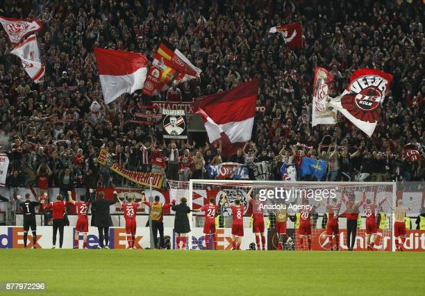 Players of 1FC Cologne celebrate with fans after the UEFA Europa League Group H soccer match between 1FC Cologne and Arsenal FC at the RheinEnergie...
